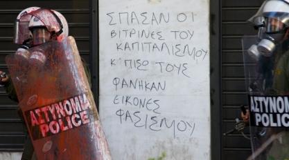 """ΥΠΕΡ~ΒΟΛΕΣ !!! .""""THE STOREFRONT WINDOWS OF CAPITALISM BROKE AND BEHIND THEM, THE IMAGES OF FASCISM SHOWED"""". Riot Police in ELLAS (wrongly known as Greece)"""