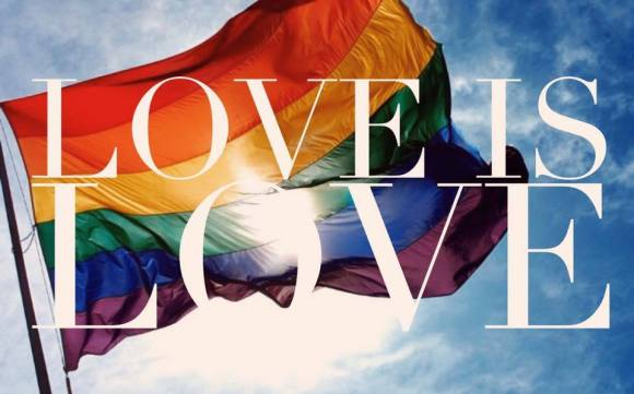 Gay flag soaring - Love is Love