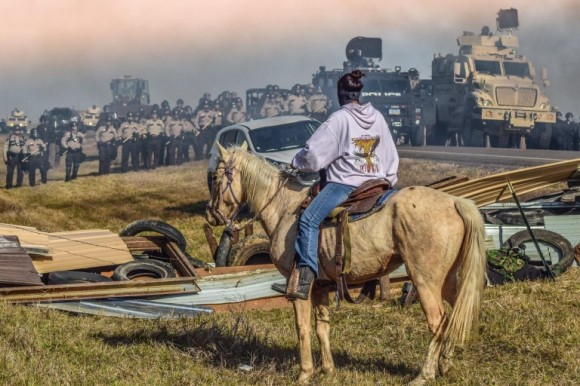 Riot Police U.S.A. - photo by Redhawk - Standing Rock Rising - the iconic picture of